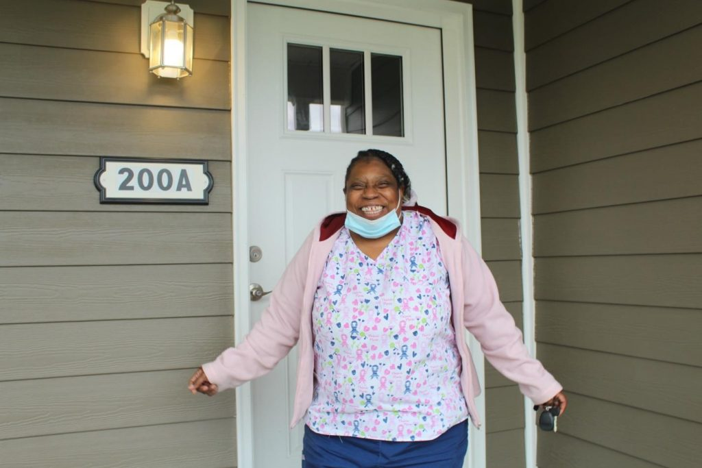 Amy Nichols outside of her new home