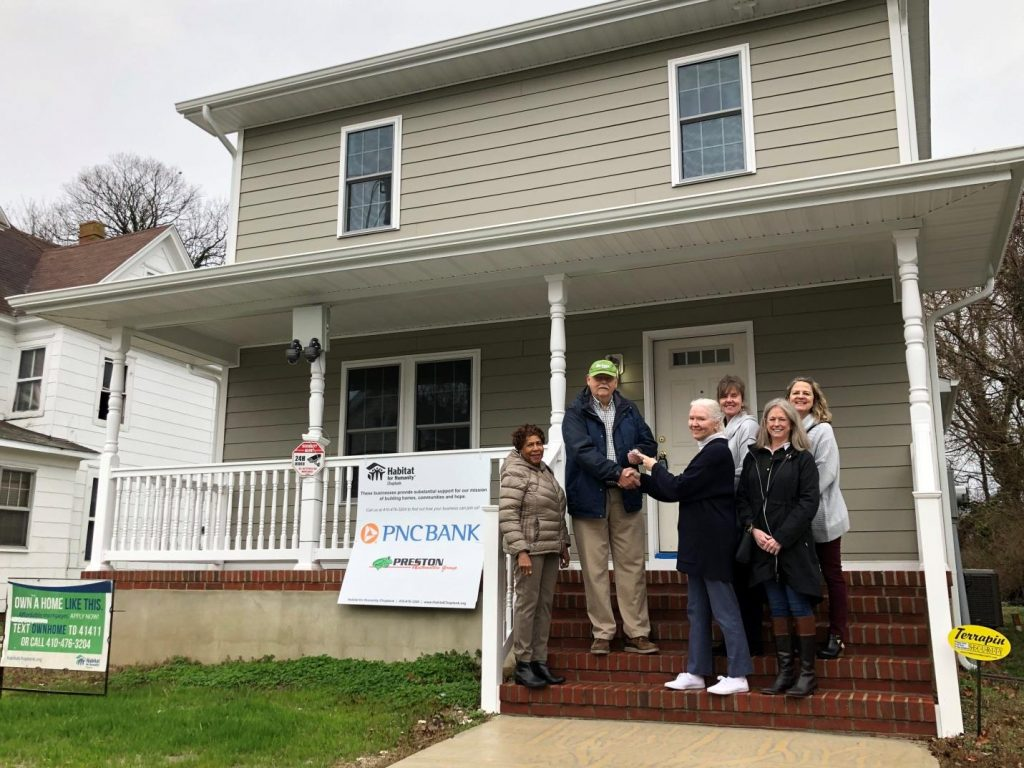 Pictured here are Barbara Hubbard, Julia Moore, and Laurie Cowin (in front) from the Waddell Foundation presenting the donation check to George Fox, JoAnn Hansen and Jenny Schmidt (in back) from Habitat for Humanity Choptank at one of the homes built by Habitat Choptank on High Street in downtown Cambridge. Photo taken in February.